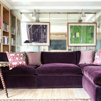 Purple Velvet Sofa & Mirror Wall