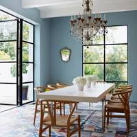 Blue Dining Room with Wishbone Chairs and Concrete Tiles