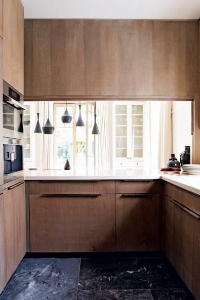 Open-plan kitchen with wooden units