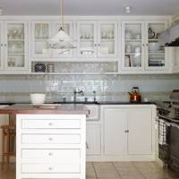 White Kitchen with Glass-Fronted Cabinets