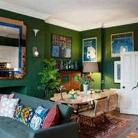 Green Dining Room With Framed Posters