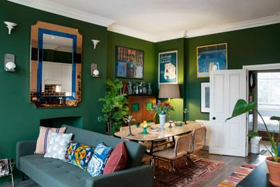 Green Dining Room With Mirror And Art