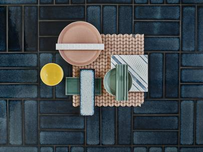 A selection of tiles from Claybrook's debut collection. In the background: porcelain stoneware 'Raku' (yokohoma), £2.59. Clockwise from top: glazed terracotta 'Cannes' (florence), £13.45; recycled glass 'Confiserie Mosaic' (blush chevron), £7.68; glazed ceramic 'Metro Deco Dado' (penn station), £1.79, and 'Metro Deco' (penn station), 50p; porcelain stoneware 'Raku' (sapporo), £2.59; glazed ceramic 'Sagrada Border 1' (nave), £3.98. All prices are for a single tile. Bowls and plate, stylist's own