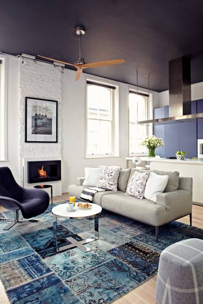 Blue and white industrial living room in Shoreditch