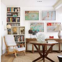 Small white living room with mid-century furniture & art