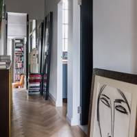 Narrow White Hallway with Art