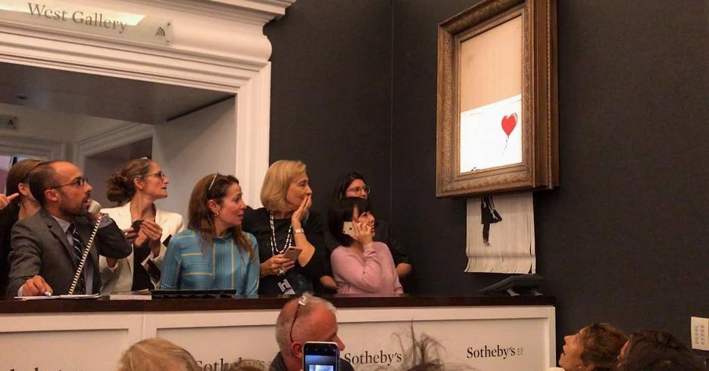 Banksy shreds his own £1 million painting after it sells at Sotheby's