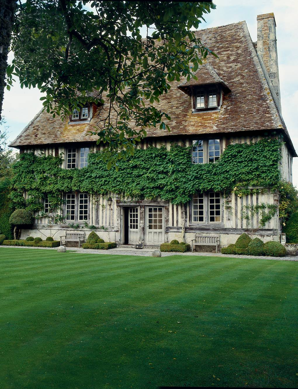 A refined Normandy manor house with formal gardens designed by Russell Page