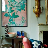 Living room in aqua and coral colour scheme