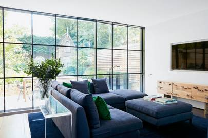 Modern living room with floor-to-ceiling windows