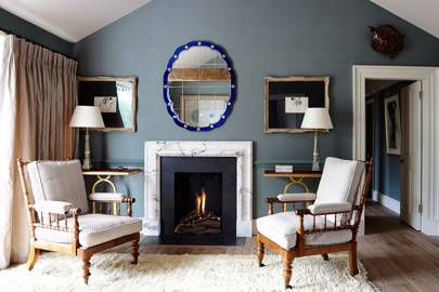 Grey living room with fifties Italian mirror
