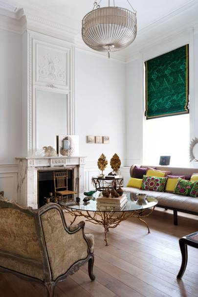 White living room with green blind and bespoke furniture