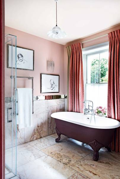 Pink Bathroom with Purple Clawfoot Bath