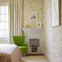 Wallpapered bedroom with green accents