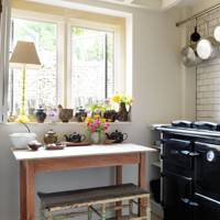 A black and white kitchen where pottery abounds