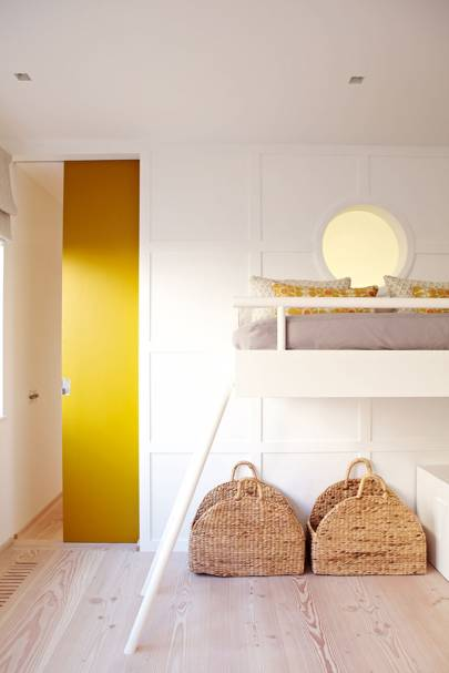Small loft bedroom with yellow accents