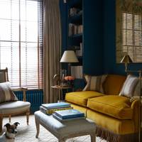 Blue living room with yellow accents