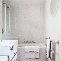 Wraparound carrera marble bathroom