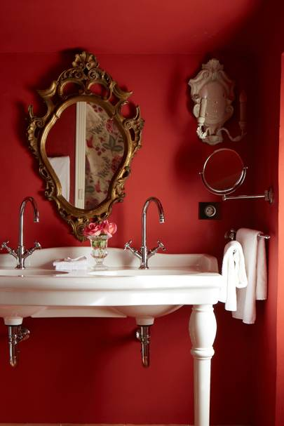White double sink against vibrant red walls