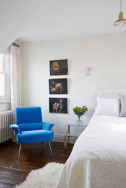 White Bedroom with Bright Blue Chair