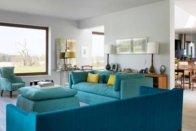 Living room with modern turquoise sofa
