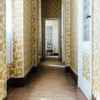 Hallway with gold & cream wallpaper