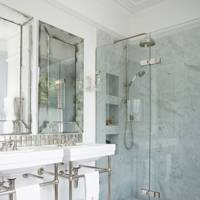Carrara marble shower with glass screen