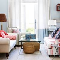 Light blue living room with florals and stripes