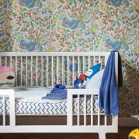Nursery with colourful wallpaper