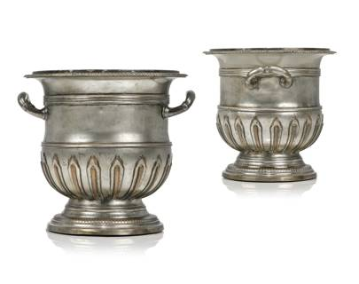Lot 80: A Pair of French Silvered-Copper and Bronze Refraichissoirs, 19th century (estimate £4,000-£6,000)