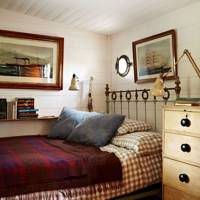 Small wood panelled bedroom