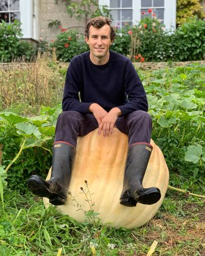 Charlie McCormick and one of his prize winning giant pumpkins