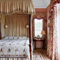 Spare room with embroidered bed cover