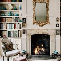 Traditional fitted bookshelves and fireplace