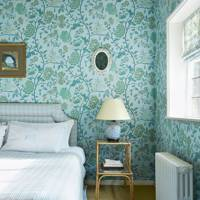 Blue bedroom with floral wallpaper