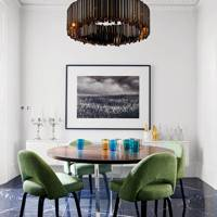 Modern dining space with statement lighting