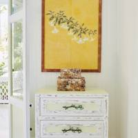 Yellow painting on white wall