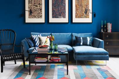 Blue living room with marbled wrapping paper in IKEA picture frames
