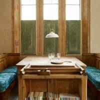 Dining room with reclaimed wooden pews