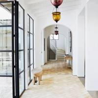 White Hallway with Glass Coloured Pendant Lights