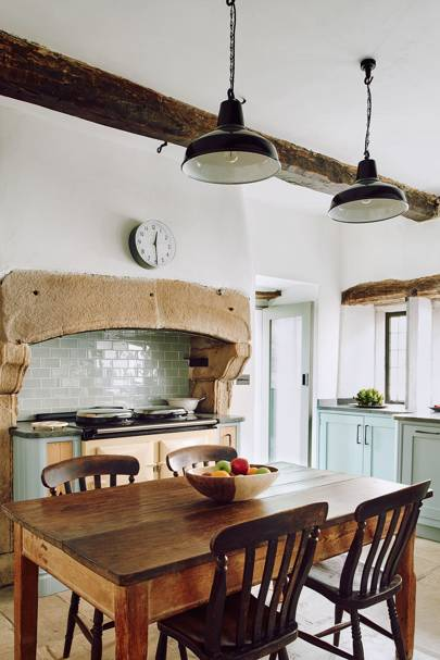 Modern Country Kitchen in Kitchen Design Ideas. A white Modern Country Kitchen with industrial pendant lights and rustic furniture.