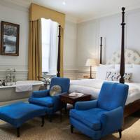 Vintage Blue Armchairs & Four-Poster Bed