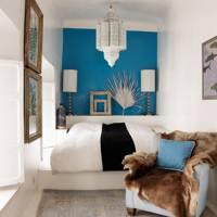 Narrow bedroom with a blue feature wall