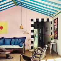 Pink Living Room with Blue Painted Beams