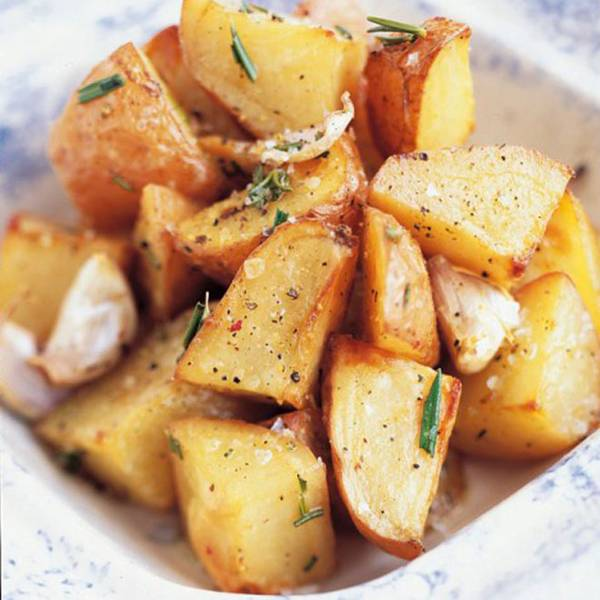 Roast potatoes cooked in olive oil, garlic, and rosemary