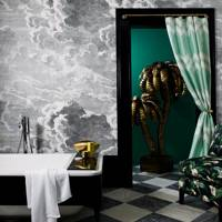 Glamorous bathroom with Fornasetti cloud wallpaper