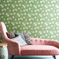 Living room with patterned green wallpaper and pink daybed