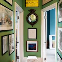 Green Hallway with Framed Posters and Prints