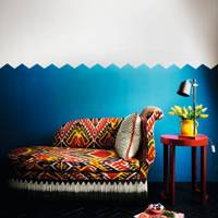 Ikat print sofa with blue walls