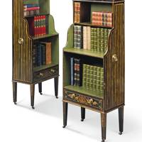 Lot 148: A Pair of George III Black-And-Gilt and Green-Japanned Waterfall Bookcases, circa 1800 (estimate £4,000-£6,000)